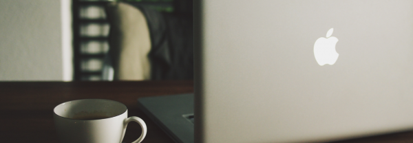 Mac Laptop and Cup of Coffee